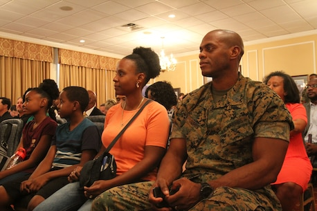 U. S. Marine Corps Master Sgt. Glen Gumbs and his spouse, Nicole, and their two children attend the Military Child Educational Summit, July 24, at Marine Corps Logistics Base Albany. As the school year quickly approaches, active-duty families aboard MCLB Albany received information about various school districts and educational opportunities in Southwest Georgia. Leaders from both public and private schools showcased their programs. (U.S. Marine Corps photo by Re-Essa Buckels)