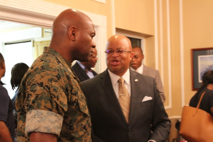 Marine Corps Logistics Base Albany Commanding Officer Col. Alphonso Trimble (left) spoke to Dougherty County Superintendent Kenneth Dyer (right), during the Military Child Educational Summit, July 24. As the school year quickly approaches, active-duty families aboard MCLB Albany received information about various school districts and educational opportunities in Southwest Georgia. Leaders from both public and private schools showcased their programs. (U.S. Marine Corps photo by Re-Essa Buckels)