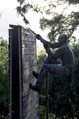 Capt. Nathan Spradley, 902nd Security Forces Squadron operations officer, climbs an obstacle July 23 at Joint Base San Antonio-Camp Bullis in preparation for the 2018 Defender Challenge. The competition will pit security forces teams against each other in realistic weapons, dismounted operations and relay challenge events.