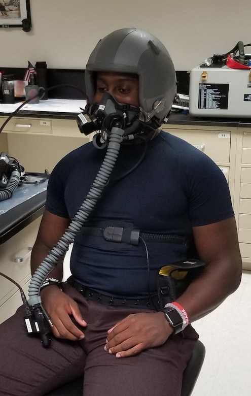 Anthony Turner, a research consultant with the 711th Human Performance Wing at Wright-Patterson Air Force Base, Ohio, wears PHYSIO, a compression undershirt, during lab testing. The undershirt is designed to provide continuous monitoring of multiple vital signs while in flight to enhance aircrew safety. (Courtesy photo illustration)