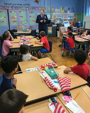 U.S. Air Force Capt. John DeLaurentis, 363rd Intelligence, Surveillance and Reconnaissance Wing deputy director, plans and programs, speaks to students at Sherman Elementary School in Roselle, New Jersey, May 30, 2018. DeLaurentis spoke to the first-grade class about their goals in hopes to inspire and motivate them. (Courtesy Photo)