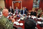 Mario Abdo Benitez, President-elect of Paraguay, listens to U.S. Navy Adm. Kurt Tidd.