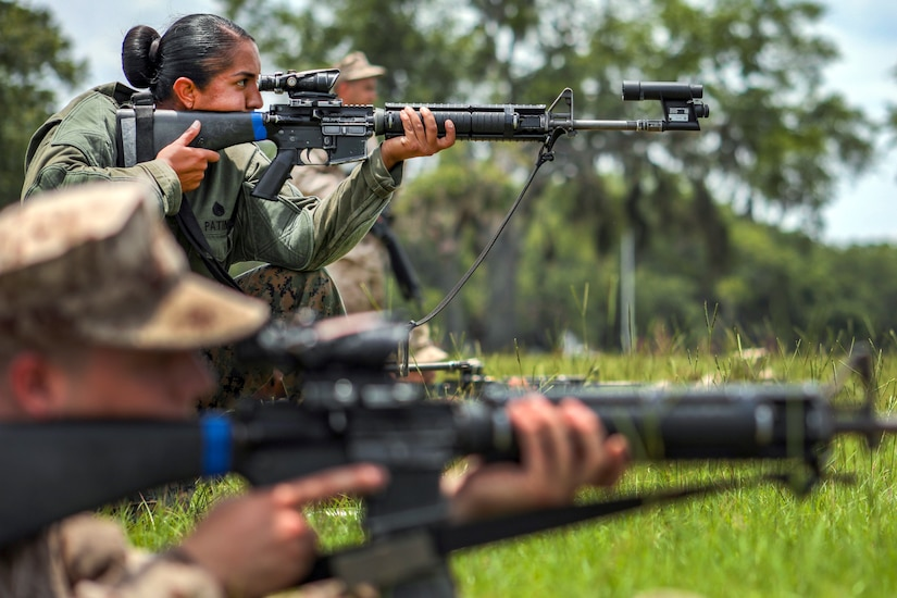Marine Corps Staff Sgt. Estefania Patino corrects the optics on a weapon.