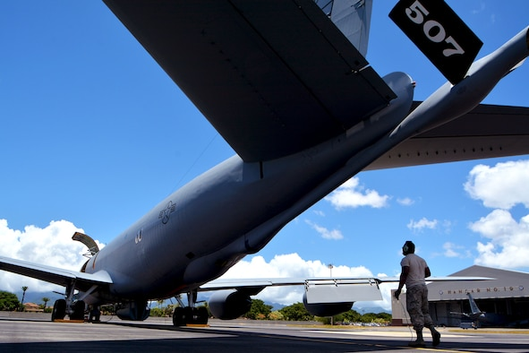 Staff Sgt. Reginald Felton, 507th Maintenance Squadron crew chief, prepares a KC-135R Stratotanker for flight, July 9. Twenty-five nations, 46 ships, five submarines, and about 200 aircraft and 25,000 personnel are participating in RIMPAC from June 27 to Aug. 2 in and around the Hawaiian Islands and Southern California. The world's largest international maritime exercise, RIMPAC provides a unique training opportunity while fostering and sustaining cooperative relationships among participants critical to ensuring the safety of sea lanes and security of the world's oceans. RIMPAC 2018 is the 26th exercise in the series that began in 1971. (U.S. Air Force photo by Tech. Sgt. Samantha Mathison)