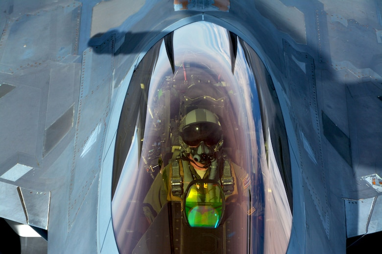 A 154th Wing Hawaii Air National Guard F-22 Raptor pilot performs in-flight refueling with a 434th Air Refueling Wing KC-135 Stratotanker from Grissom Air Reserve Base, Indiana, near Hawaii during the Rim of the Pacific (RIMPAC) exercise July 17. Twenty-five nations, 46 ships, five submarines, and about 200 aircraft and 25,000 personnel are participating in RIMPAC from June 27 to Aug. 2 in and around the Hawaiian Islands and Southern California. The world's largest international maritime exercise, RIMPAC provides a unique training opportunity while fostering and sustaining cooperative relationships among participants critical to ensuring the safety of sea lanes and security of the world's oceans. RIMPAC 2018 is the 26th exercise in the series that began in 1971. (U.S. Air Force photo by Tech. Sgt. Samantha Mathison)