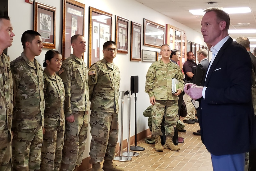Deputy Defense Secretary Patrick M. Shanahan speaks to soldiers lined up in a hall.