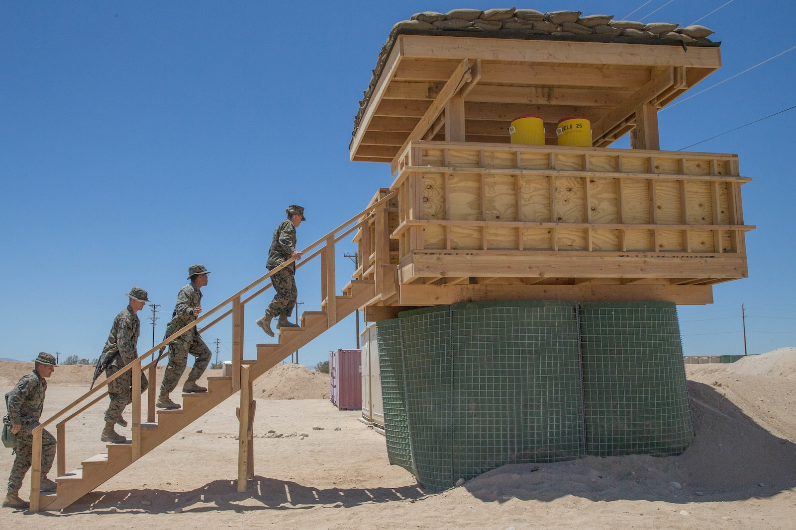 Brig. Gen. Helen G. Pratt, commanding general of 4th Marine Logistics Group, and Sgt. Maj. Lanette N. Wright, sergeant major of 4th MLG,tour the guard towers built during Integrated Training Exercise 4-18 by Combat Logistics Regiment 45.