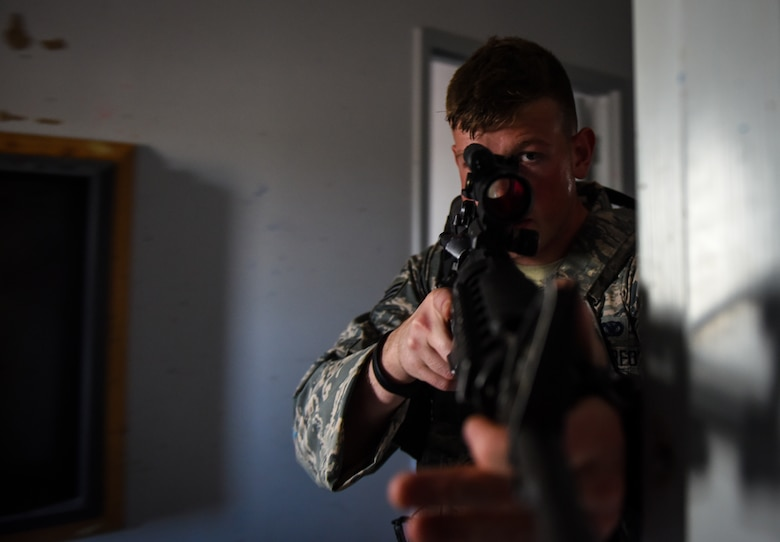 Senior Airman Nicholas Rauch, 460th Security Forces Squadron defender, sweeps a hallway during a field exercise in preparation for the Defenders Challenge July 27, 2018, on Buckley Air Force Base, Colorado. Buckley AFB defenders trained in simulated situations such as hostage recovery and neutralizing active shooters. (U.S. Air Force photo by Airman 1st Class Michael D. Mathews)