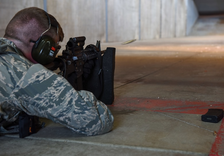 Senior Airman Nicholas Rauch, 460th Security Forces Squadron defender, sends a round into a target in preparation for the Defenders Challenge July 27, 2018, on Buckley Air Force Base, Colorado. Defenders were judged on their accuracy with the M-9 Beretta and M16 rifle during a Defenders Challenge event. (U.S. Air Force photo by Airman 1st Class Michael D. Mathews)