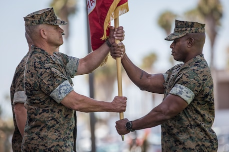 U.S. Marine Corps Lt. Gen. Lewis A. Craparotta, left, the outgoing commanding general of I Marine Expeditionary Force, receives the colors from Sgt. Maj. James K. Porterfield, the sergeant major of I MEF, during a change of command ceremony at Camp Pendleton, California, July 30, 2018. During the ceremony, Craparotta relinquished command of I MEF to Lt. Gen. Joseph L. Osterman. (U.S. Marine Corps photo by Lance Cpl. Dalton S. Swanbeck)