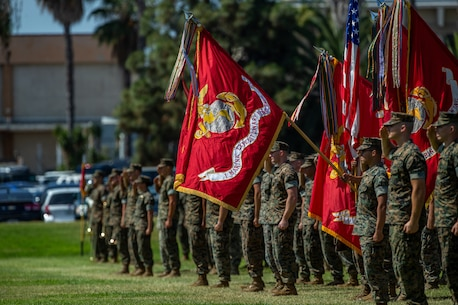 The I Marine Expeditionary Force colors and American flag are presented during the I MEF change of command ceremony July 30, 2018, at Camp Pendleton, California. During the ceremony, Lt. Gen. Lewis A. Craparotta relinquished command of I MEF to Lt. Gen. Joseph L. Osterman. (U.S. Marine Corps photo by Lance Cpl. Megan Brown)