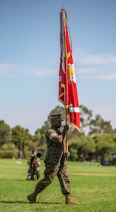 U.S. Marine Corps Sgt. Maj. James Porterfield, I Marine Expeditionary Force sergeant major, carries the I MEF battle colors to Lt. Gen. Lewis A. Craparotta, the outgoing commanding general of I MEF, during the I MEF change of command ceremony July 30, 2018, at Camp Pendleton, California. During the ceremony, Craparotta relinquished command of I MEF to Lt. Gen. Joseph L. Osterman. (U.S. Marine Corps photo by Cpl. Jacob A. Farbo)