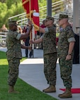 U.S. Marine Corps Sgt. Maj. James Porterfield, left, I Marine Expeditionary Force sergeant major, passes the I MEF battle colors to Lt. Gen. Lewis A. Craparotta, the outgoing commanding general of I MEF, during the I MEF change of command ceremony July 30, 2018, at Camp Pendleton, California. During the ceremony, Craparotta relinquished command of I MEF to Lt. Gen. Joseph L. Osterman. (U.S. Marine Corps photo by Cpl. Jacob A. Farbo)