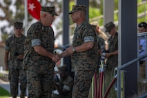 U.S. Marine Corps Lt. Gen. David H. Berger, left, commanding general of U.S. Marine Corps Forces Pacific, shakes hands with Lt. Gen. Lewis A. Craparotta, the outgoing commanding general of I Marine Expeditionary Force, during the I MEF change of command ceremony July 30, 2018, at Camp Pendleton, California. (U.S. Marine Corps Photo by Cpl. Jacob A. Farbo)