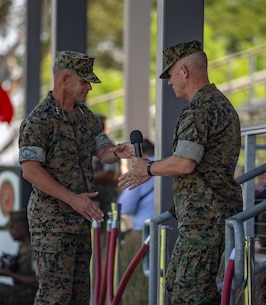 U.S. Marine Corps Lt. Gen. Lewis A. Craparotta, left, the outgoing commanding general of I Marine Expeditionary Force, shakes hands with Lt. Gen. Joseph L. Osterman, the incoming commanding general, during the I MEF change of command ceremony July 30, 2018, at Camp Pendleton, California.  Prior to assuming his duties as the commanding general of I MEF, Osterman served as the deputy commander of United States Special Operations Command. (U.S. Marine Corps photo by Cpl. Jacob A. Farbo)