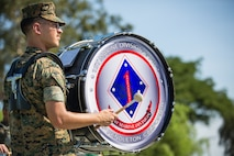 U.S. Marine Corps Cpl. Eric Shulman, a musician with the 1st Marine Division Band, plays a drum during the I Marine Expeditionary Force change of command ceremony held at Camp Pendleton, California, July 30, 2018. During the ceremony, Lt. Gen. Lewis A. Craparotta relinquished command of I MEF to Lt. Gen. Joseph L. Osterman. (U.S. Marine Corps photo by Lance Cpl. Dalton S. Swanbeck)