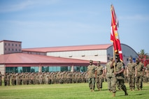 U.S. Marine Corps Sgt. Maj. James K. Porterfield, the sergeant major of I Marine Expeditionary Force, carries the colors during the I MEF change of command ceremony at Camp Pendleton, California, July 30, 2018. During the ceremony, Lt. Gen. Lewis A. Craparotta relinquished command of I MEF to Lt. Gen. Joseph L. Osterman. (U.S. Marine Corps photo by Lance Cpl. Dalton S. Swanbeck)