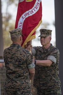 U.S. Marine Corps Lt. Gen. Lewis A. Craparotta, left, the outgoing commanding general of I Marine Expeditionary Force, transfers the colors to Lt. Gen. Joseph L. Osterman, the incoming commanding general, during a change of command ceremony at Camp Pendleton, California, July 30, 2018. During the ceremony, Craparotta relinquished command of I MEF to Osterman. (U.S. Marine Corps photo by Lance Cpl. Dalton S. Swanbeck)