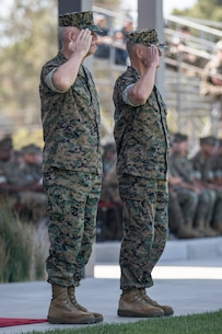 U.S. Marine Corps Lt. Gen. Joseph L. Osterman, left, the incoming commanding general of I Marine Expeditionary Force and Lt. Gen. Lewis A. Craparotta, the outgoing commanding general, salute for the pass in review during a change of command ceremony at Camp Pendleton, California, July 30, 2018. During the ceremony, Craparotta relinquished command of I MEF to Osterman. (U.S. Marine Corps photo by Lance Cpl. Dalton S. Swanbeck)