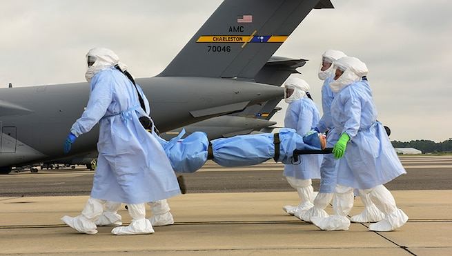 Airmen from the 628th and 375th Aeromedical Evacuation Squadrons out of Joint Base Charleston, S.C. and Scott Air Force Base, Ill. transport a simulated patient during a training exercise July 18, 2018 at Joint Base Charleston. The goal of the training was to implement and evaluate the procedures of transportation for highly infectious patients from one location to another via aeromedical transportation.
