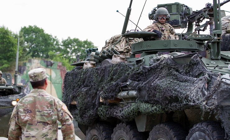 A 2d Cavalry Regiment stryker crew queues for ammunition distribution during a training event during U.S. Army Europe's exercise Saber Strike 18, Powidz, Poland, June 1