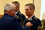 Air Force Maj. Gen. Anthony J. Carrelli, the adjutant general of the Pennsylvania National Guard, awards Army Sgt. Jordy Brewer, an infantryman with the Kentucky Army National Guard's Company A, 1st Battalion, 149th Infantry Regiment, the top honor in the Noncommissioned Officer of the Year category in the 2018 Army National Guard Best Warrior Competition at Fort Indiantown Gap, Pennsylvania, July 27, 2018. Brewer beat out six other Soldiers from throughout the Army Guard to win the category, and will go on to compete in the 2018 all-Army Best Warrior Competition later in the year.