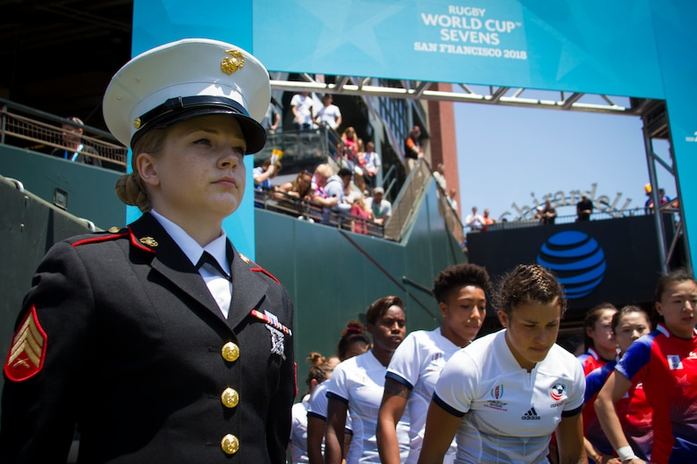 Sgt. Nichole Stoehrer, a marketing and communication Marine at Recruiting Station San Francisco, stands in the honor guard to welcome the USA Rugby women's team onto the pitch during the Rugby World Cup Sevens in San Francisco, July 20, 2018. This year, the Marine Corps attended the Rugby World Cup Sevens as part of its partnership with USA Rugby. Rugby players tend to share the fighting spirit embodied in Marines and by partnering with USA Rugby, the national governing body for the sport in America, the Marine Corps will reach a broad cross-section of high school and collegiate-aged rugby players as well as an ever-growing influencer network of coaches, referees, rugby alumni and parents. Stoehrer is from Rutherfordton, North Carolina, and to the right of Stoehrer stands Nicole Heavirland, a native of Whitefish, Montana.