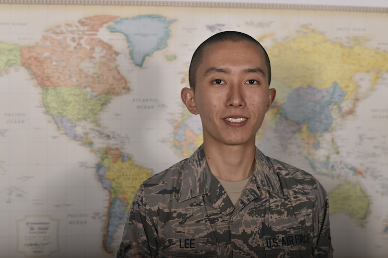 Airman Junjhyun Lee, a 319th Comptroller Squadron debt management apprentice, stands in front of a world map June 11, 2018, on Grand Forks Air Force Base, North Dakota. Lee is originally from Seoul, South Korea, and joined the Air Force for the education and career opportunities. (U.S. Air Force photo by Airman 1st Class Melody Wolff)