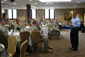Dennis Flynn, the Commerce City, Colorado Police Department Commander, provides an impactful presentation about PTSD to Airmen during the Enlisted Leadership Symposium, Jul. 25, at Youngstown-Warren Air Reserve Station in Vienna, Ohio. Flynn brought a unique perspective to the table because he worked as a hostage negotiator for several years where he encountered veterans suffering from PTSD firsthand.