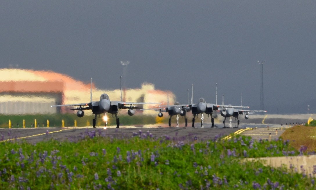 Four F-15C Eagles assigned to the 493rd Expeditionary Fighter Squadron taxi at Keflavik Air Base, Iceland, July 30, 2018 in support of NATO's Icelandic Air Surveillance mission. IAS promotes regional stability and security, while strengthening partner capabilities and fostering trust. (U.S. Air Force photo/ Staff Sgt. Alex Fox Echols III)