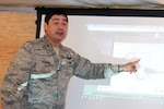 Air National Guard officer points to chart.