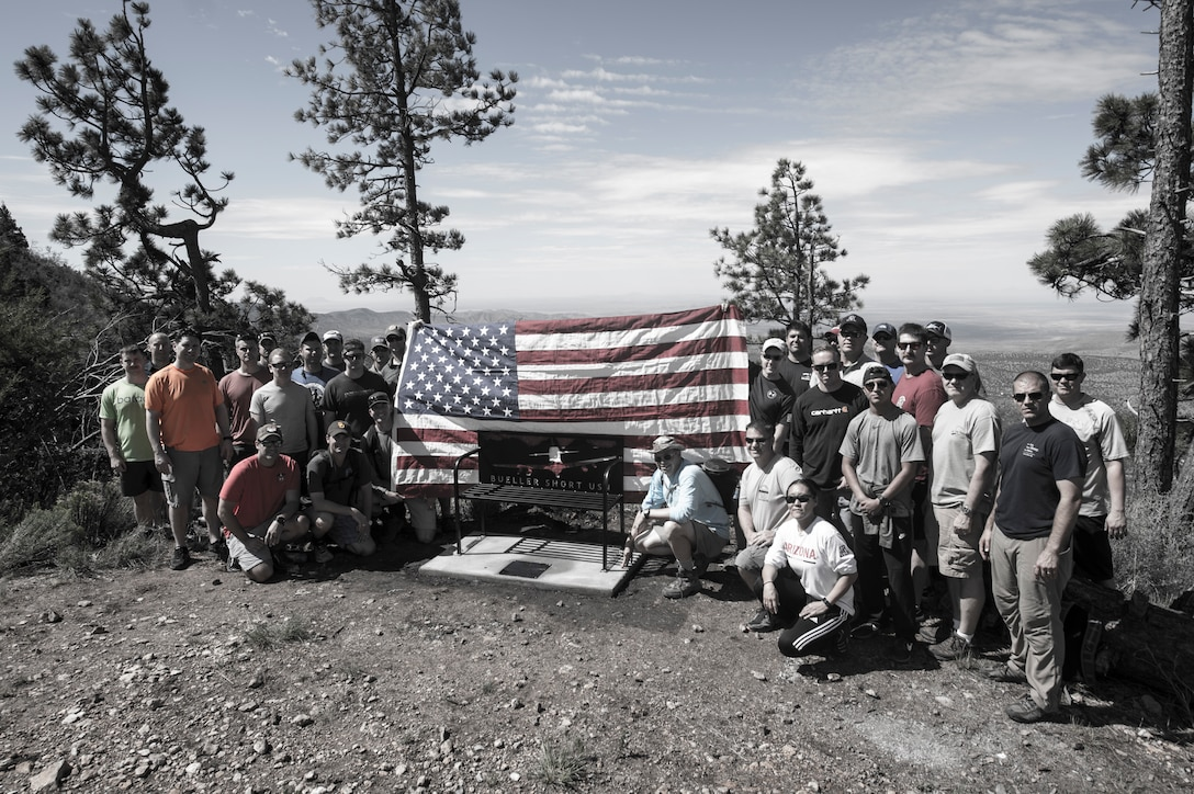"In memory of Lt. Christopher ""Bueller"" Short, U.S. Navy pilot, a bench was placed at the end of the Rim Trail in the Tularosa Basin, N.M., July 13, 2018. Short lost his life when an A-29 Super Tucano crashed over the Red Rio Bombing Range, June 22, 2018. (U.S. Air Force photo illustration by Senior Airman Chase Cannon)"