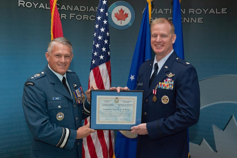 1 Canadian Air Division Commanding Officer, Major General Christian Drouin presents the Commanders Commendation to Lieutenant Colonel Ethan McKenna during the Detachment 1, First Airforce change of command ceremony on June 18th, 2018 at 1 CAD, Winnipeg.  Photo by: Cpl Bryce Cooper, 17 Wing Imaging