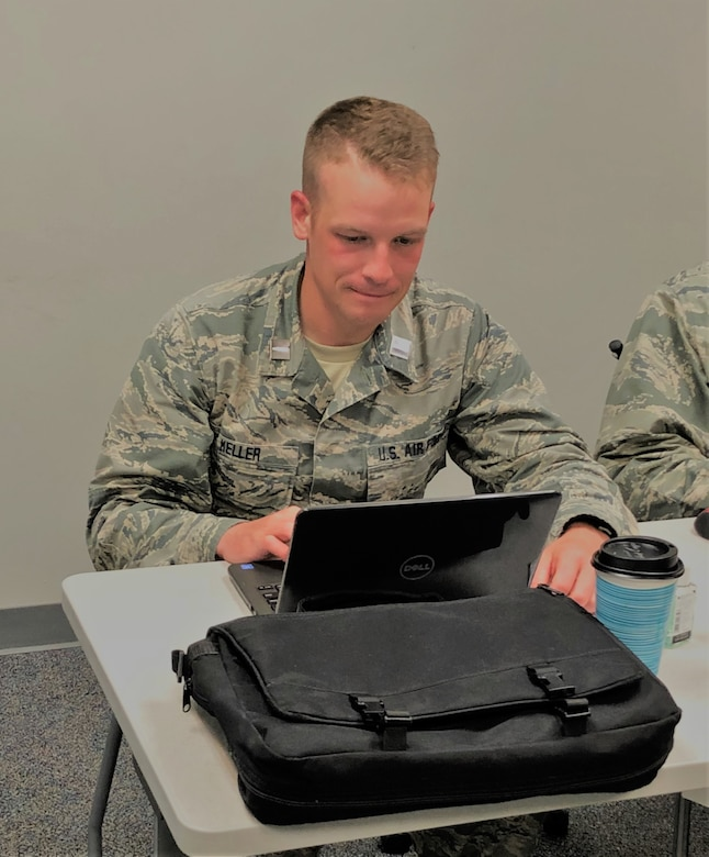 Cadet Eric Keller studies his course materials in preparation of his last assessment to ensure graduation from Total Force Officer Training at Maxwell AFB, Ala., July 18, 2018. (U.S. Air Force photo/Cadet Breck Simmons)