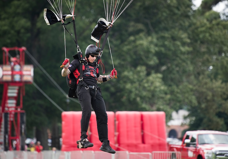 A U.S. Army Special Operations Command Black Daggers Parachute Demonstration Team member parachutes down to the drop zone during the Fort Eustis 100th Anniversary Open House at Joint Base Langley-Eustis, Virginia, July 28, 2018.
