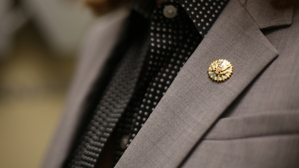 Civilian personnel of the Defense Contract Management Agency are now able to purchase and wear the new organization badge and lapel pin. (DCMA photo by Elizabeth Szoke)