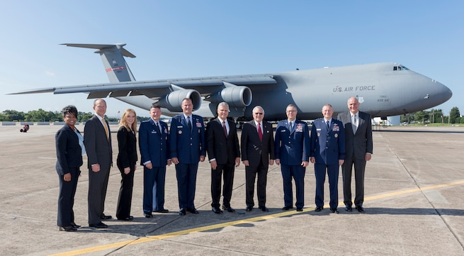 Group of people in front of a C-5 aircraft.