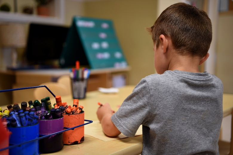 A child participates in arts and crafts at the Child Development Center, July 26, 2018, on Buckley Air Force Base, Colorado. The CDC staff supports the development of the whole child and provides active, hands on learning experiences to meet the individual needs of each child in the program. (U.S. Air Force photo by Airman 1st Class Codie Collins)