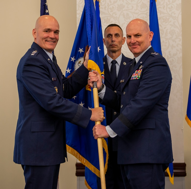 Maj. Gen. Sam Barrett takes the 18th Air Force guidon from Gen. Carlton Everhart, and assumes command of 18th AF during a ceremony July 31, at Scott Air Force Base, Ill. Barrett comes to 18 AF from his position as the Director of operations, Strategic Deterrence and Nuclear Integration, Headquarters Air Mobility Command, Scott AFB. (U.S. Air Force photo by Airman 1st Class Chad Gorecki)
