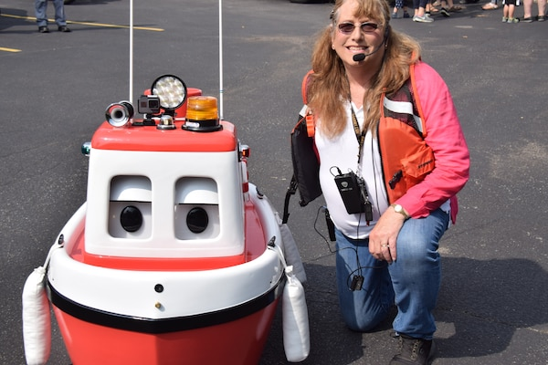 U.S. Army Corps of Engineers, Buffalo District procurement technician Jean Brockner and her friend, Cory the Tugboat, visited the Bornhava school's Vehicle Day, July 26, 2018, educating kids and adults on water safety.