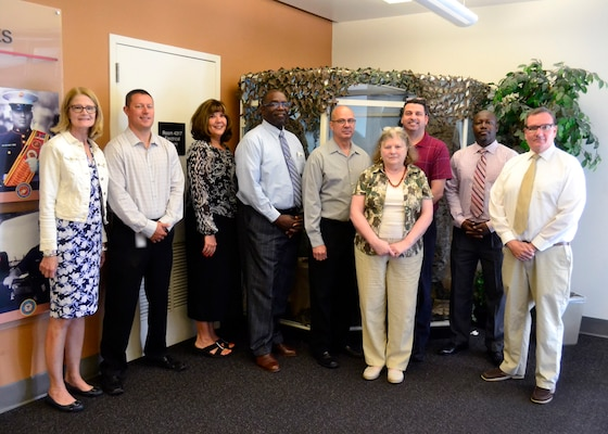 DLA Troop Support Clothing and Textiles' Type III Navy Working Uniform Planning Team won DLA's Team of the Year Award for their support of the Navy's latest utility uniform transition. The cross-functional team met weekly to meet the Navy's requirements, including an accelerated timeline and 400 distinct items encompassing varying sizes of five uniform items.