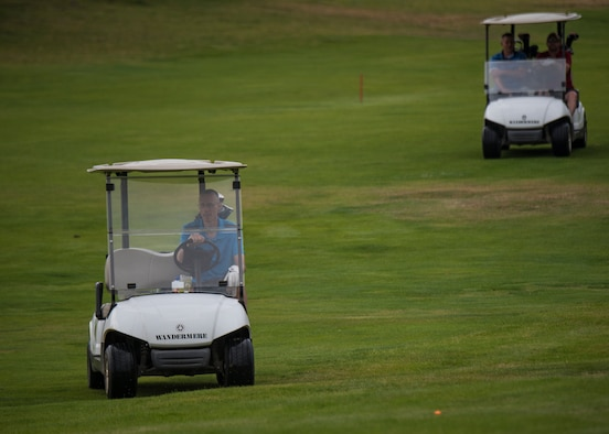 U.S. Air Force Chief Master Sgt. Lee Mills, 92nd Air Refueling Wing command chief, leads his team to the next golf hole during the 24th Annual Operation Warmheart Golf Tournament at Wandermere Golf Course in Spokane, Washington, July 27, 2018. Fairchild Airmen participated in the tournament to raise money to provide goods and support for Airmen and their families when facing difficult times. (U.S. Air Force photo/ Airman 1st Class Whitney Laine)