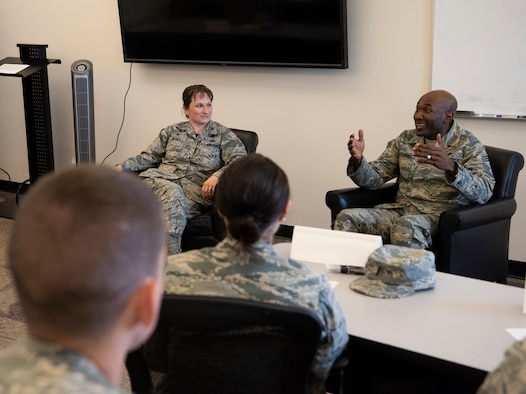 Col. Jennifer Grant, commander of the 50th Space Wing, and Chief Master Sgt. Boston Alexander, command chief of the 50th SW, speak with company grade officers during the CGO professional enhancement course at Schriever Air Force Base, Colorado, July 27, 2018. The course was designed to augment the professional education of CGO's through mentorship. (U.S. Air Force photo by Staff Sgt. Matthew Coleman-Foster)