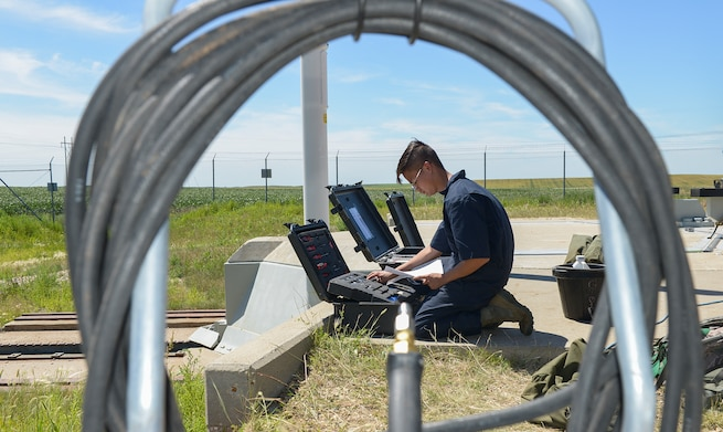Senior Airman Randell Bowen, 91st Missile Maintenance Squadron facilities maintenance section team member, checks accountability for tools at a launch facility near Minot Air Force Base, North Dakota, July 17, 2018. During code change, these maintainers are responsible for maintaining all launch facilities and launch control centers. (U.S. Air Force photo by Senior Airman Jonathan McElderry)