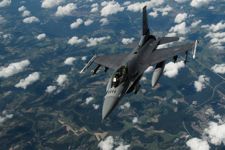 After refueling, the F-16 broke away from the KC-135R and continued its training.