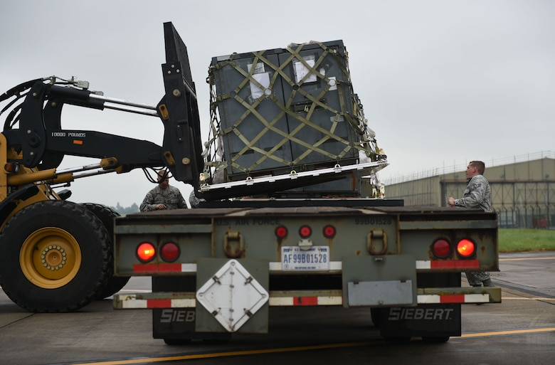 U.S. Air Force Airmen assigned to the 345th Expeditionary Bomb Squadron from Dyess Air Force Base, Texas, load pallets onto a trailer for disbursement at RAF Fairford, U.K., May 24, 2018. Dyess Airmen deployed to the United Kingdom in support of NATO cross-servicing exercises which regularly involve combined theater security engagements with allies and partners, demonstrating the U.S. capability to command, control and conduct bomber missions across the globe. (U.S. Air Force photo by Senior Airman Emily Copeland)