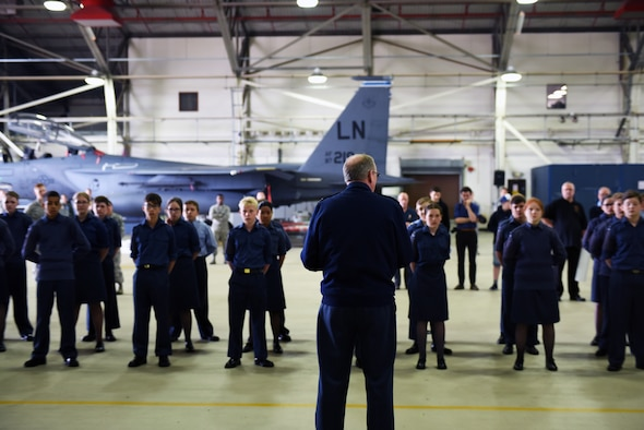 Squadron Leader Jerry Neild, Royal Air Force Lakenheath commander, speaks to a group of RAF cadets during a cadet day event at RAF Lakenheath, England, May 30, 2018. Cadet Day is an opportunity to provide young RAF cadets a chance to learn how the U.S. Air Force and RAF work together. (U.S. Air Force photo/Airman 1st Class Christopher S. Sparks)