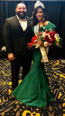 Texas Army National Guard Soldier and Mrs. Texas Galaxy, Staff Sergeant San Juanita Escobar, poses for photos with her husband after winning the Mrs. Texas Galaxy Pageant, March 10, 2018.