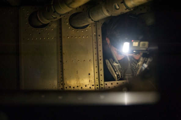 U.S. Air Force Senior Airman Triston Evans, an aircraft fuel systems journeyman assigned to the 6th Maintenance Squadron, squeezes through the interworking of a KC-135 Stratotanker training fuel cell at MacDill Air Force Base, Fla., May 30, 2018.