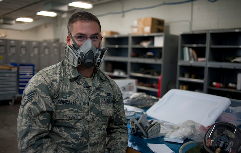 U.S. Air Force Staff Sgt. Adrian Gonzalez, an aircraft fuel systems craftsman with the 6th Maintenance Squadron, demonstrates how to wear a respirator at MacDill Air Force Base, Fla., May 30, 2018.